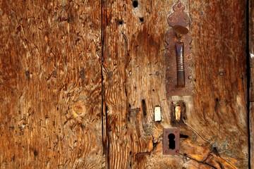 Aged wood door grunge texture rusty handle