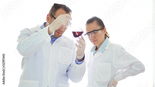 Scientists couple Works in Lab