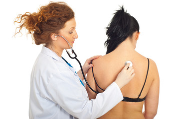 Doctor checkup back woman