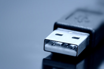 USB Cable on dark reflective background