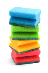 Several dishwashing colourful sponges on a white background