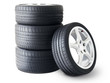 Isolated set of low section summer tyres with one wheel in front