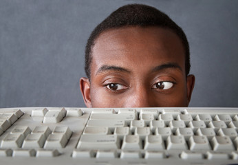 Eyes of Man Above Keyboard