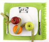 Fototapety Fruits with measuring tape on a plate like weight scale