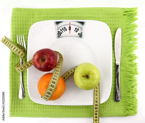 Fruits with measuring tape on a plate like weight scale