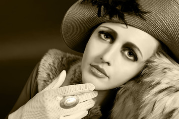 Retro style imitating fashion portrait of a young woman in hat.