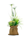 Artificial bouquet in small sack on white background