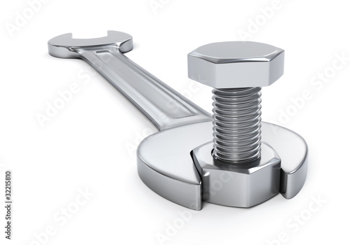 Wrench fixing nut and bolt - isolated