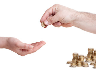 one hand giving 10 cents euro coin to other hand
