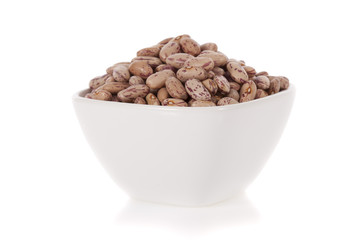 Pinto beans in a bowl isolated on a white background.