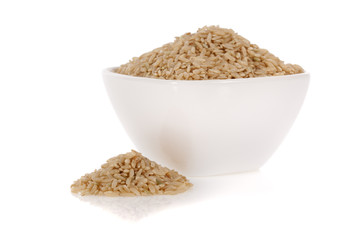Brown rice in a bowl isolated on a white background.