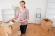 Young blond-haired woman preparing to move house