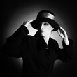Fashion portrait of elegant woman in black and white