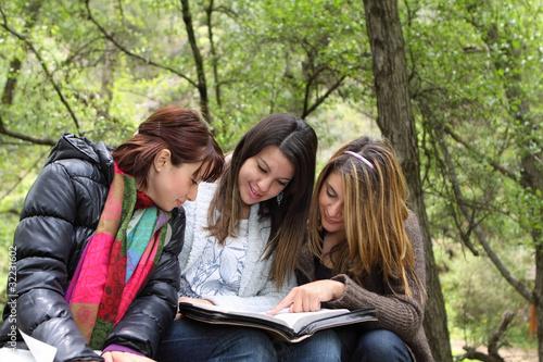 3 Girls Reading Together