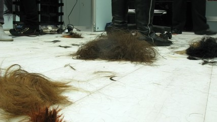 Pieces of hair cut at floor