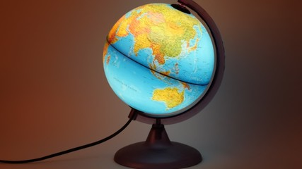 Globe with inner backlight turning around in dark room