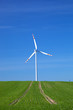 Wind Turbine on green field. Alternative energy