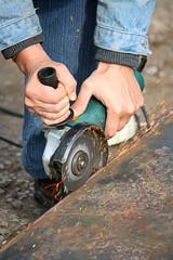 A grinding wheel cuts a metal