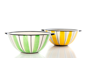 two colorful striped dishes isolated over whitebackground