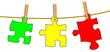 Puzzleteile auf Wäscheleine