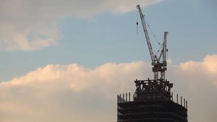 modern building under construction against blue sky