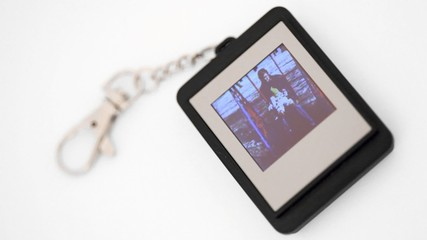 trinket with liquid-crystal display showing family photos