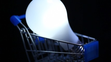 close-up shot of electric lamp in toy shopping trolley rotating