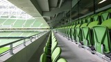 Green seats of the stadium, bright cloudless day.