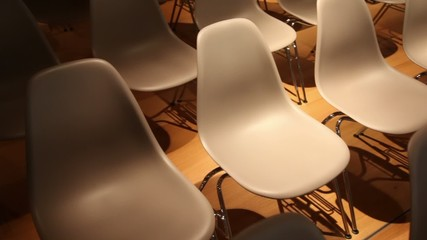 Subdued light, the rows of chairs.