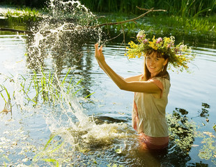 girl playing into water