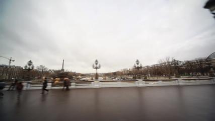 bridge Alexander III over River Seine, far seen Eiffel Tower