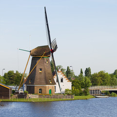Dutch windmill, house and bridge