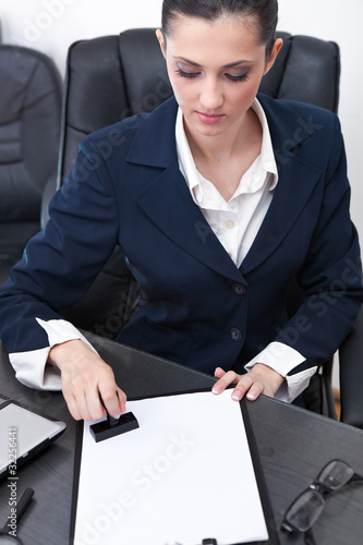 businesswoman stamping documents