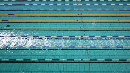 sports swimming pool with strained ropes separating lanes