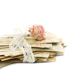 Stack of old love letters (1890-1910), lace and rose flower