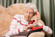 The elderly woman speaks on phone