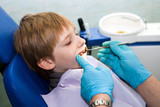 Boy opening his mouth wide during inspection of oral cavity poster