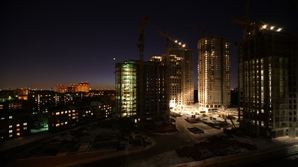 Overview of construction site in night, time lapse