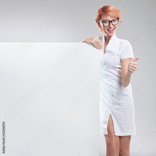 Happy smiling woman with white board
