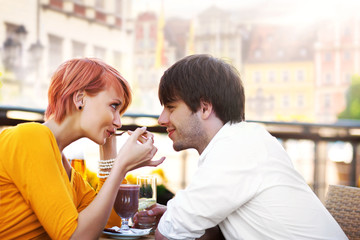 Cute young couple eating lunch