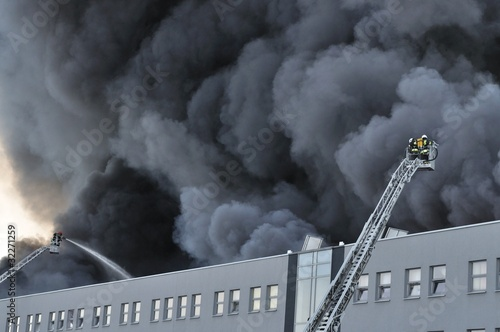 Firefighters fighting a fire at a warehouse