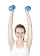 Fit active girl lifting weights for fitness