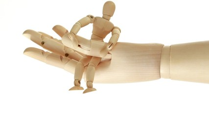 rotation of wooden toy giant arm with little toy man