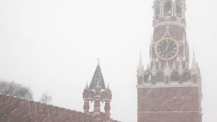 Moscow Kremlin's Spasskaya Tower under windy showfall