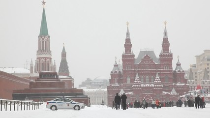 Large group of people at Moscow Red Square under snowfall