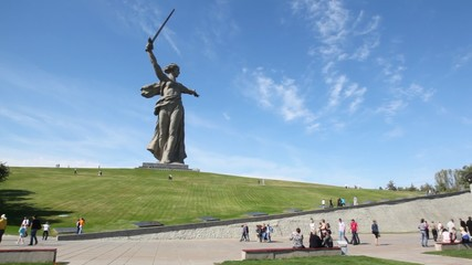 Monument of Native land-mother in Volgograd, people are nearby