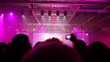 People look concert of popular music and records it on camera