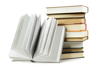 stack of books in hard cover and one opened book in front, isola