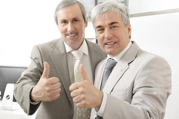 Portrait of two businessmen who approve.