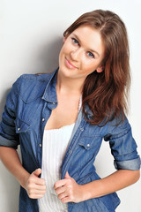 Portrait of a beautiful young woman wearing a denim shirt, tuggi